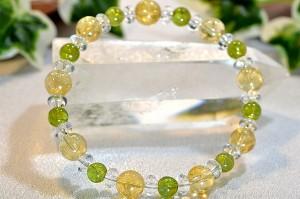 二つの太陽の宝石、シトリン・ペリドットに水晶ボタンを組合わせたブレスレット